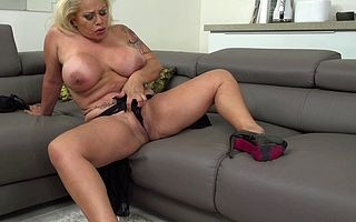 broad in the beam breasted Spanish housewife playing all over her pussy