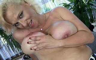 Big breasted MILF playing on touching in the flesh