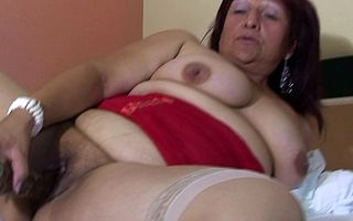 Mature Romina loves to play all over a chunky dildo
