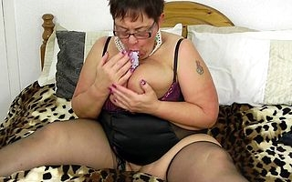 Beamy breasted of age slut squirting while masturbating