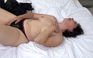 Hairy fullgrown lady masturbating out of reach of her bed